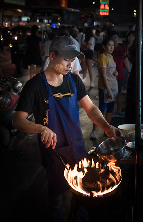 Chinatown, Bangkok. Don't know what he was cooking, but he did it with a flair (flare?).