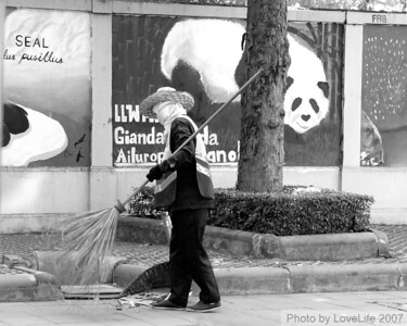Street cleaner ~ Notice the covered face against pollution.  Bangkok
