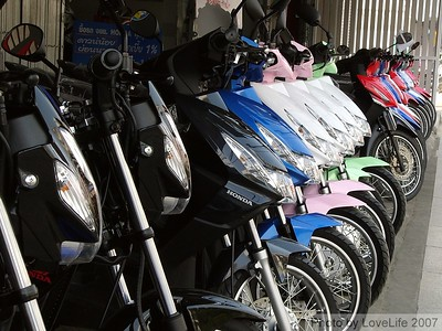 Chang Rai's favorite mode of transportation. There is one street where there are 10 motorbike stores in a row.
