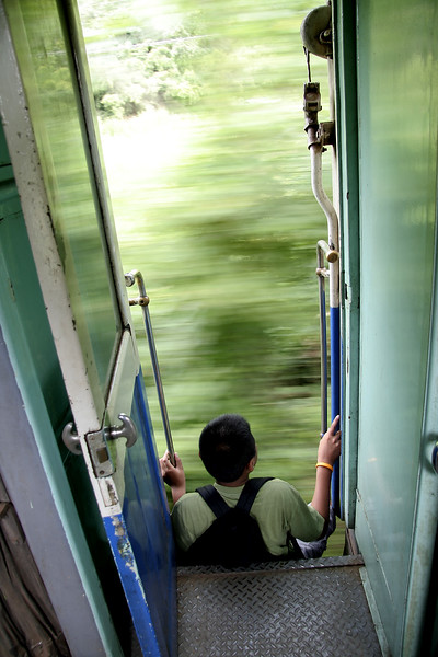 Young passenger takes the more thrilling seat on the train