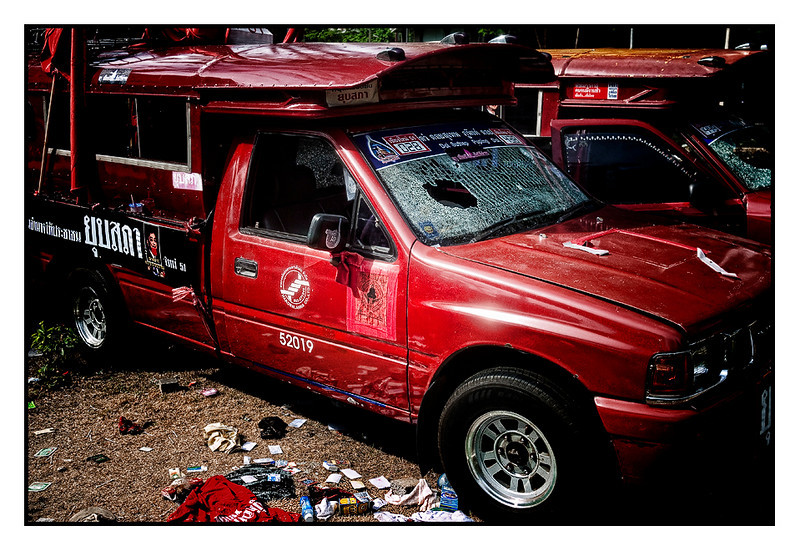 Red supporters left cars behind (I wonder about the driver, looking at the damage on the windshield)