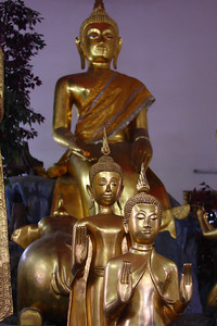 Three Buddhas with rear-end of elephant