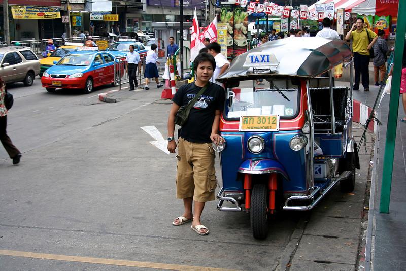 Bangkok July 2005 Tuk tuk driver in the streets of Bangkok