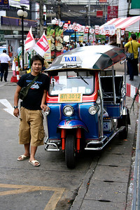 Bangkok July 2005 Tuk tuk driver in the streets of Bangkok