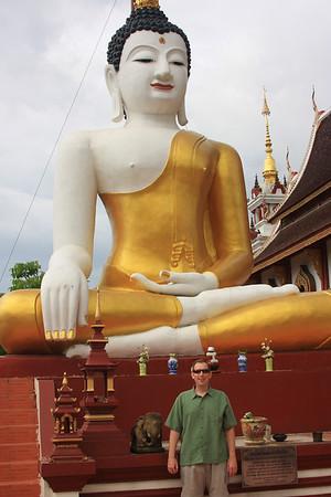 Buddha standing near statue