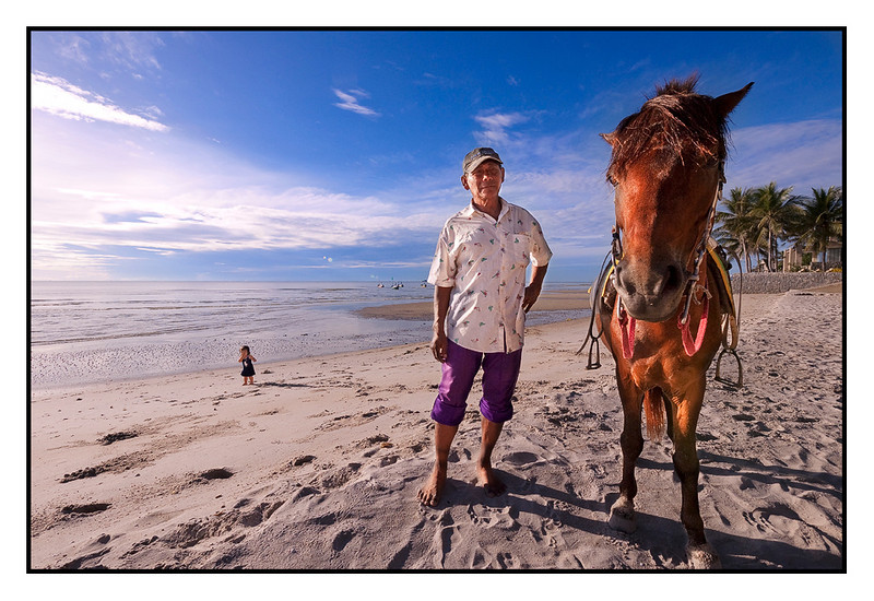 Horse rental on the beach, and look at that tiny thing in the background...