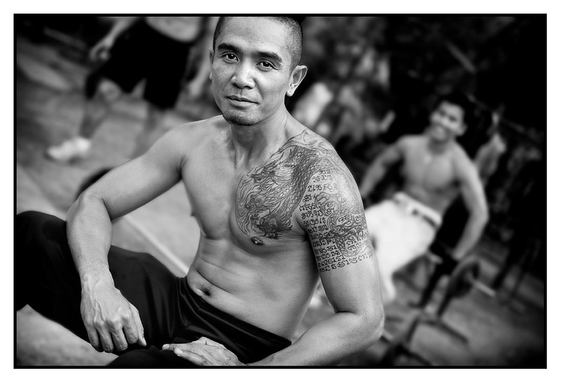 Khun Somnuk<br /> <br /> Lumpini Park in Bangkok has the coolest outdoor gym, very very basic but with very dedicated guys working out. I will spend some time here later to try to portrait the feeling, but here is a start... Need to get accepted first among the guys...