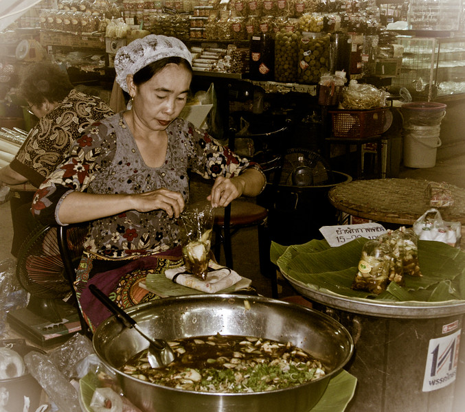 Woman preparing food to sell in the market in Chiang Mai.