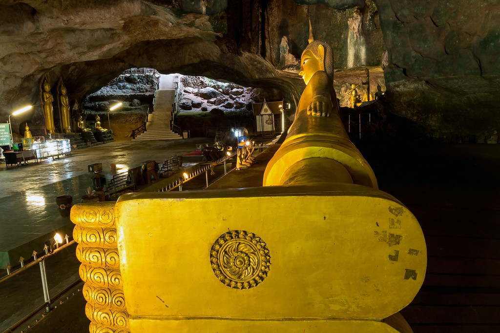 The 15 meter long Golden Reclining Buddha at Wat Suwannakuha Temple Cave, Phang Nga