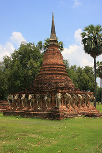 Wat Sorasak - Constructed in 1412 this chedi is supported by 24 elephants