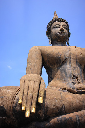 Buddha with gold leaf applied to fingernails