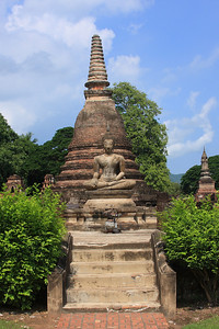 Buddha in front of a Chedi Chedis typically contained Buddhist relics or remains