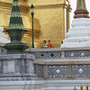 A monk taking a photo in the Grand Palace