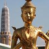 Kinnari figure, with praang in the background. Wat Phra Kaew, Bangkok.