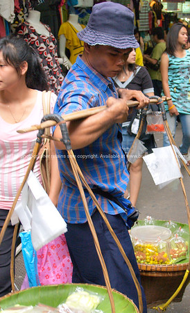Bangkok life, vendor with traditional baskets. Model released; no, for editorial & personal use.