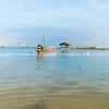 Asian idyllic coastal scene with traditional long tail fishing boat.