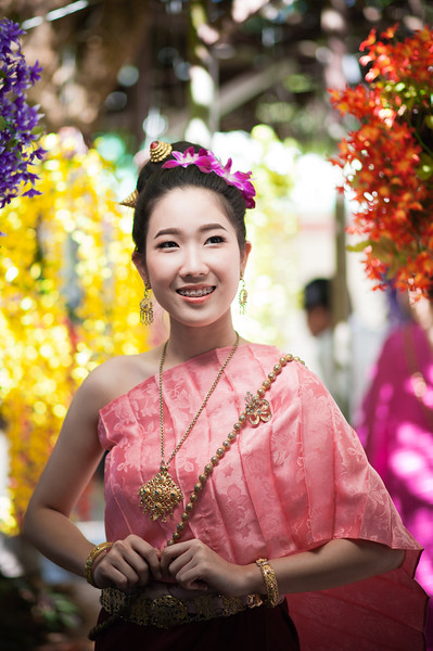 At this Buddhist temple complex we had two models in traditional Thai outfits for shooting in various lighting conditions, with colorful flowers and temples all around.