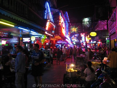 Soi Cowboy (meaning Cowboy Street) in Bangkok. Nothing but strippers and prostitutes, and neon everywhere. Crazy place.