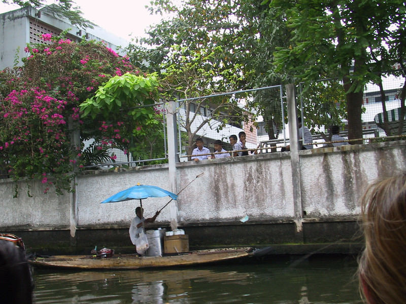 Tail boat canal tour with a local selling fried bananas to the local school boys
