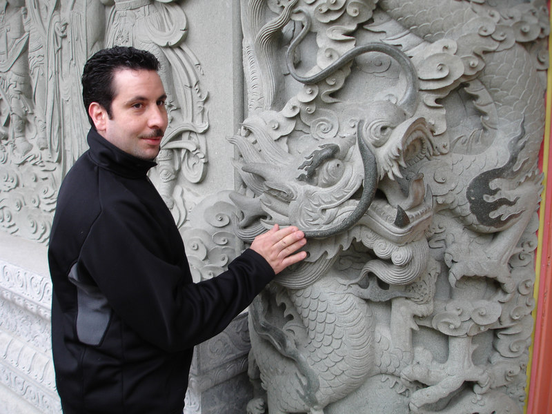 Certain parts of the dragon are shiny because they're constantly rubbed by visitors seeking good luck.
