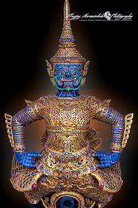Thai Royal Barge Asura  — half-bird, half-ogre —guardian figureheads. The top half of the figurehead is fierce and exudes strength, while the bird-like bottom half is delicate in design. As with the other escort barges, the figurehead straddles a bowchaser cannon port over a floral hull.