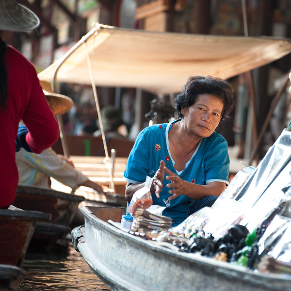 Bangkok Floating Market - selling both artwork and spices.