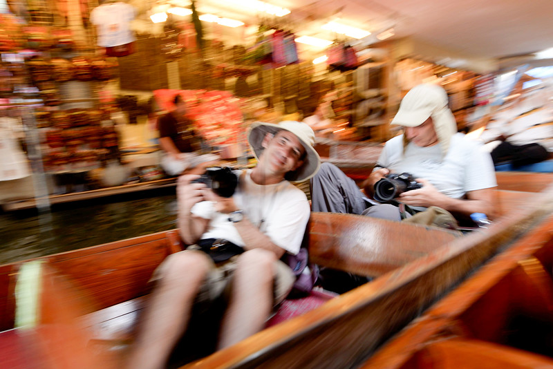 reed's picture of me - taking pictures at the floating market with another trekker Izzy.
