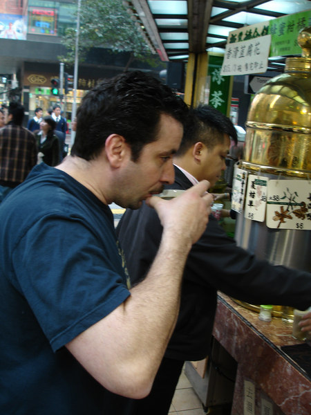 Sampling the street drinks in Hong Kong.