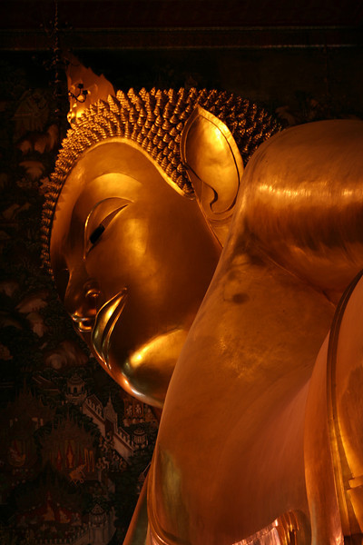 Detail of gigantic reclining Buddha, Wat Pho, Bangkok.