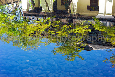 House reflected in a pool of water