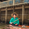 Bangkok life, woman sits looking forelornly in boat on canal.<br /> Model released; no, for editorial & personal use.