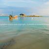 Traditional Asian long tail fishing boats moored at Bang Kao beach, Koh Samuui, Thailand.