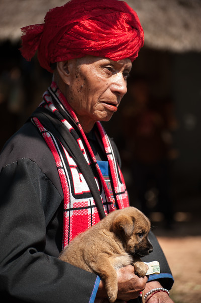 Akha hill tribe village - older man with his puppy