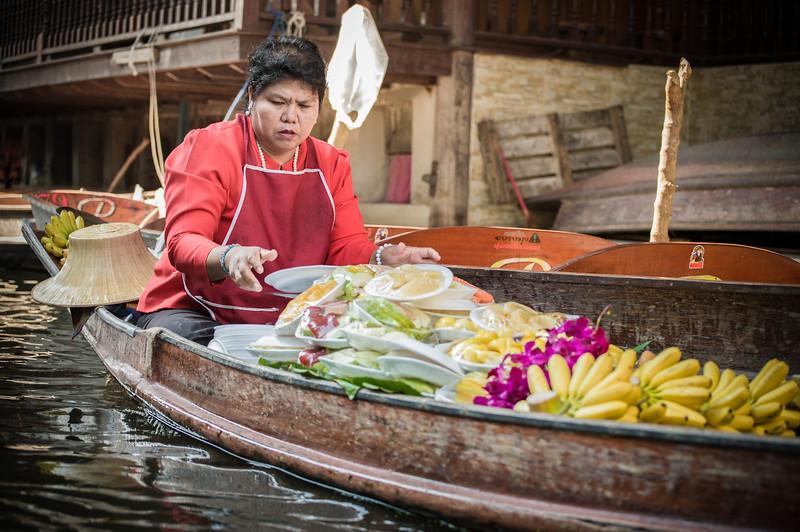 Bangkok Floating Market - selling prepared meals.