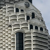 If the Romans had discovered the cantilever principle and steel-reinforced concrete, they would have probably have built skyscrapers that looked like this; State Tower, Silom Road, Bangkok... a multistorey nightmare of Ionic columns and kilometers of weddingcake-style balustrading.