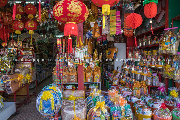 Thai giftshop of prepared gift parcels ready to be purchased for giving to Buddhist monks in temple