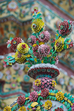 Ceramic flower decorations in a temple in Thailand