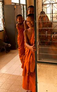 Young monk in doorway
