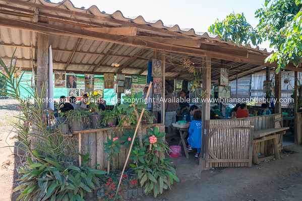 People dining in rural Thai restaurant