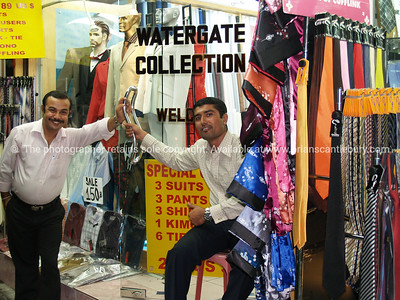 Bangkok life, the smooth talking sellers of fabrics. Model released; no, for editorial & personal use.