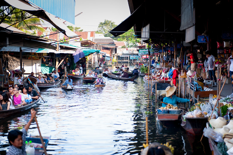 Bangkok Floating Market, where locals exchange food and goods and tourists shop for gifts