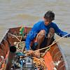 Thai Fisherman on a river in Bangkok