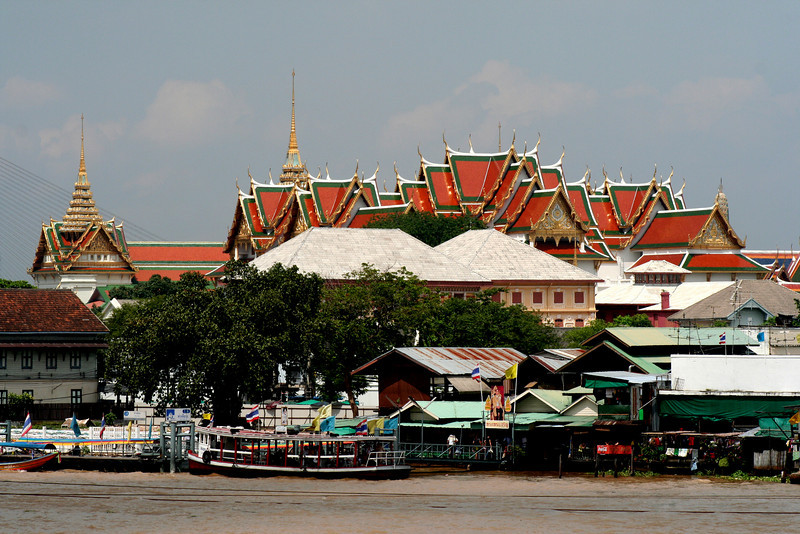 View from Wat Arun across the Chao Phraya River towards the the Grand Palace and Wat Phra Kaew, Bangkok.