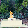 Buddha shrine surrounded by trees