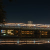 lights illuminated with lens flare strung across Narawat Bridge
