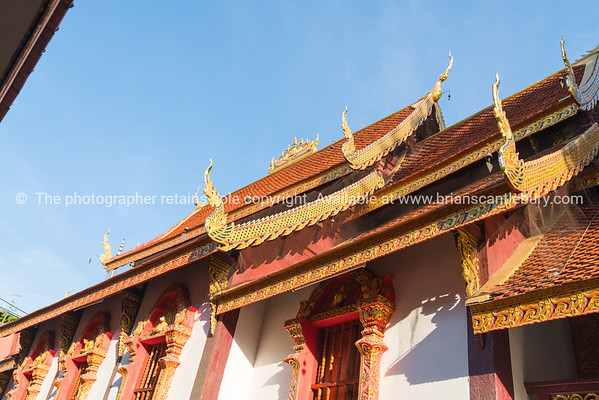 Traditional Asian style Buddhist temple gable ends and roof lines from low point of view