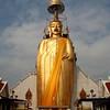 Colossal standing Buddha at Wat Intharawihan, Bangkok.