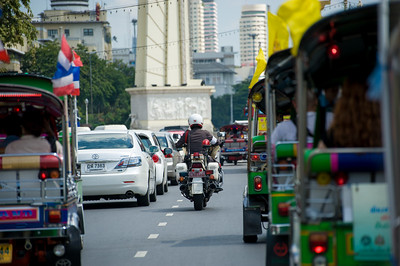 Police escorted Tuk Tuk ride arranged for us through Bangkok to next shot - riverboat tour.