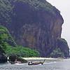 Longtails shuttle tourists between hidden beaches