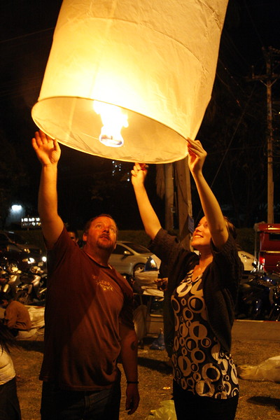 Ben and Sam sending a lantern up on New years Eve Chiang Mai.